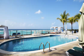 Shared pool with expansive views of the sea