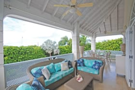 First floor sitting area and dining overlooks pool