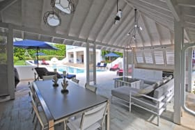 Poolside gazebo and Bar B Q suitable for dining or just relaxing