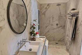 Marble lined bathroom at entrance of house