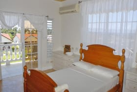 Master Bedroom opening to private balcony