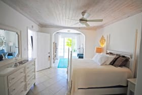 Ground floor bedroom opens to covered terrace and golf course