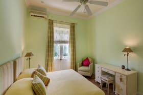 Bedroom with AC and Ceiling Fans
