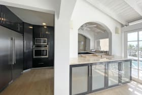 Kitchen area with commercial sized fridge