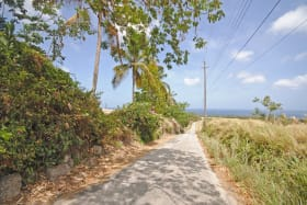Access road that runs on north of lot and leads to Mullins beach