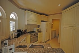 Well equipped kitchen and full sized laundry room