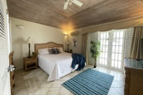 Main bedroom with doors leading to patio