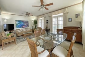Living/dining with doors to enclosed patio