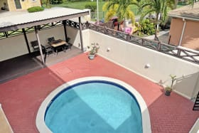 View of pool from upper level