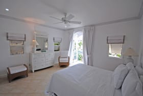 Bedroom two opens to a balcony with views of the marina