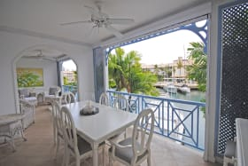Dining terrace overlooks marina and is fully screened
