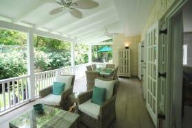 Covered verandah opens to garden