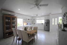 View of air conditioned dining room kitchen and entrance