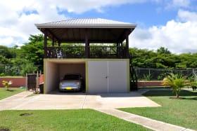 Garage, laundry and elevated gazebo at back of house