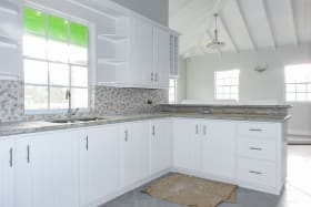 Kitchen - white cabinetry - granite countertop & wall finishing