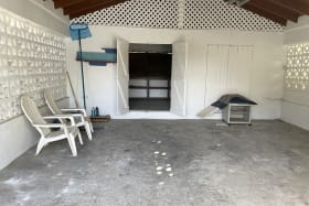 Laundry and storage room near garada