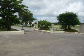 VIEW FROM MAIN BUILDING OF ENTRANCE AND PARKING AREA