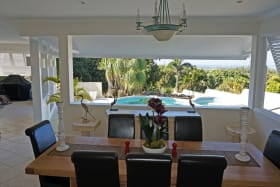 LARGE COVERED AREA SHOWING DINING AREA AND POOL
