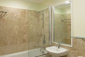 Bathrooms feature fine finishes