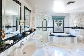 One of two master bathrooms