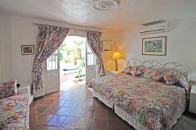 Guest bedroom on ground floor opens to poolside terrace
