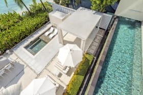 View of the main pool and beach level terrace bar and plunge pool