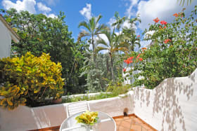Upstairs terrace with garden and pool view