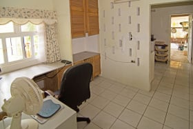 Office leads to laundry room and covered storage