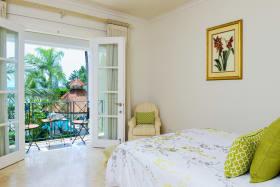 En suite bedroom opens to balcony