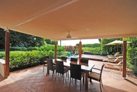 Dining veranda with garden and sea views