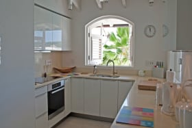 Kitchen has picture windows to the sea view and the verandah
