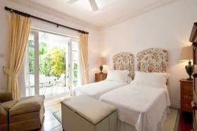 Twin bedroom opens to dining terrace and pool
