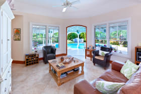 Sitting room leads to poolside verandas
