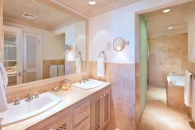 En suite master bathroom with tub and shower