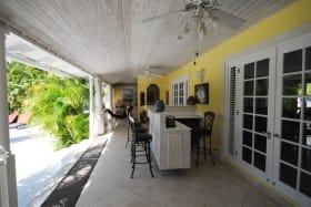 Bar on veranda leading to pool