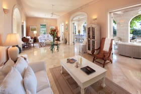 Spacious living room opens to covered veranda