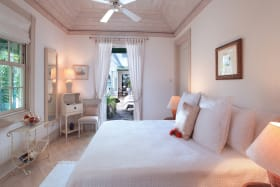 Guest bedroom on ground floor opens to pool deck