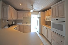 Well equipped kitchen with laundry beyond