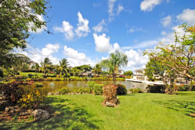 Gardens and central lake at Apes Hill Polo Villas