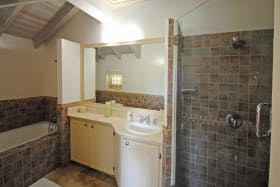 Master ensuite bathroom with tub and shower