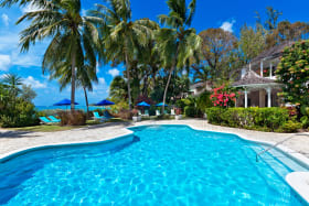 Beautiful swimming pool with coral stone deck and gardens at Emerald Beach
