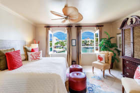 Spacious en-suite guest bedroom with a view of the lagoon