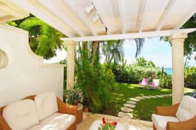 View of garden towards beach from covered veranda