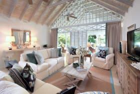 Great room opens through folding glass doors to veranda