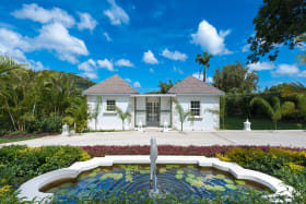Driveway fountain and view of 2 bedroom cottage entrance