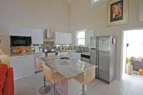Well equipped kitchen with sit up island