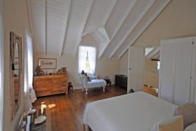 Master bedroom has wooden floors