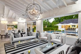 Covered verandah with dining and sitting areas