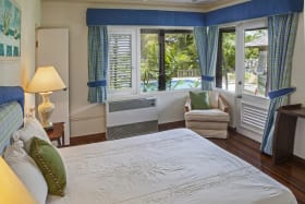 Ground floor guest bedroom with pool views