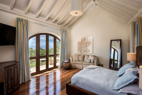 Master bedroom suite on upper level with sea views